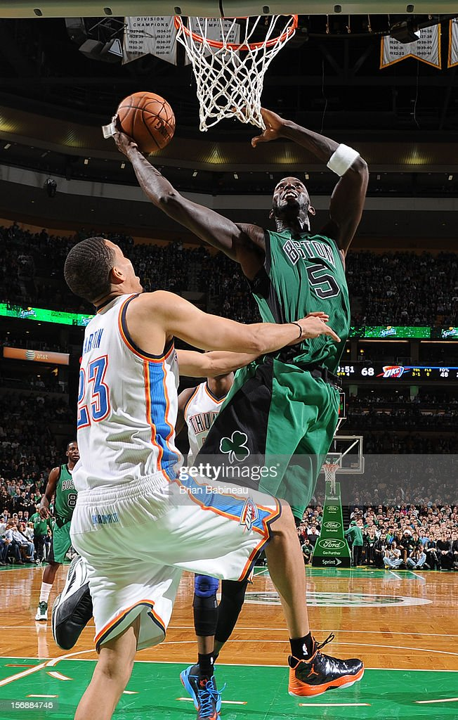 Kevin Garnett #5 of the Boston Celtics goes to the basket against Kevin Martin #23 of the Oklahoma City Thunder on November 23, 2012 at the TD Garden in Boston, Massachusetts.