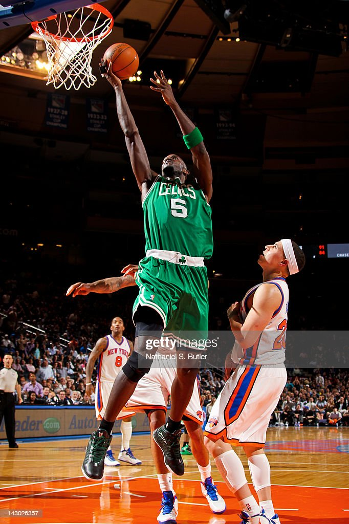 <a gi-track='captionPersonalityLinkClicked' href=/galleries/search?phrase=Kevin+Garnett&family=editorial&specificpeople=201473 ng-click='$event.stopPropagation()'>Kevin Garnett</a> #5 of the Boston Celtics goes to the basket against <a gi-track='captionPersonalityLinkClicked' href=/galleries/search?phrase=Mike+Bibby&family=editorial&specificpeople=201503 ng-click='$event.stopPropagation()'>Mike Bibby</a> #20 of the New York Knicks on April 17, 2012 at Madison Square Garden in New York City.
