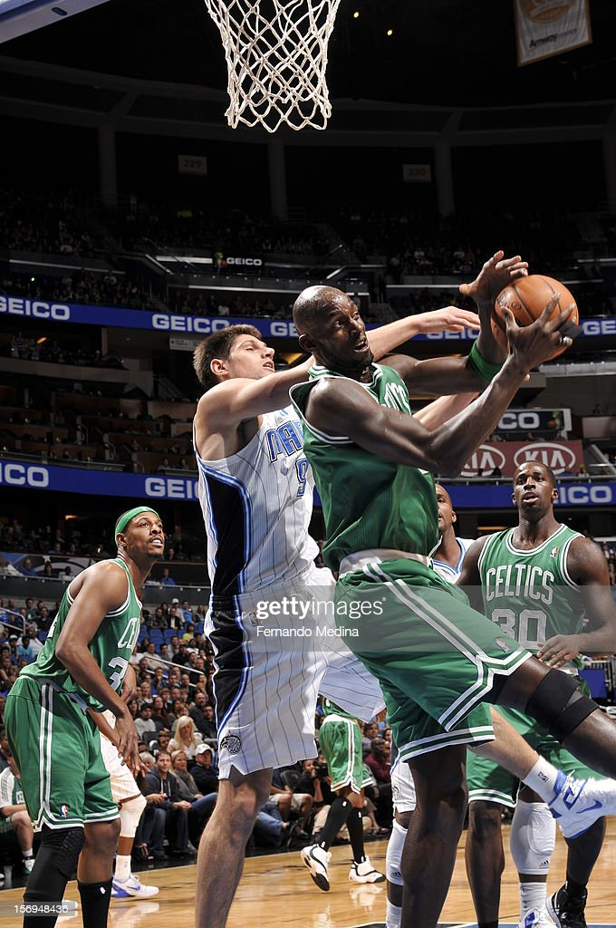 Kevin Garnett #5 of the Boston Celtics goes to the basket against Nikola Vucevic #9 of the Orlando Magic during the game between the Boston Celtics and the Orlando Magic on November 25, 2012 at Amway Center in Orlando, Florida.