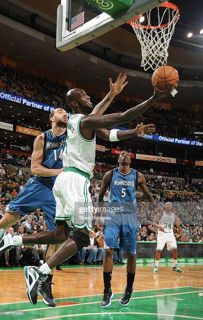 Kevin Garnett #5 of the Boston Celtics goes to the basket against Nikola Pekovic #14 of the Minnesota Timberwolves on December 5, 2012 at the TD Garden in Boston, Massachusetts.