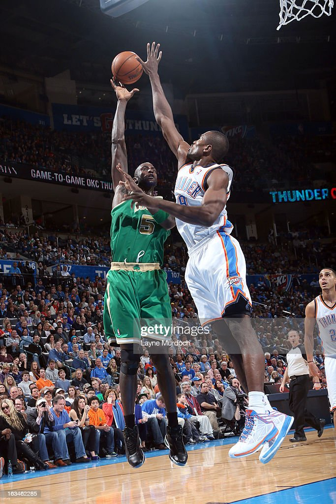 Kevin Garnett #5 of the Boston Celtics goes to the basket against Serge Ibaka #9 of the Oklahoma City Thunder during the game between the Oklahoma City Thunder and the Boston Celtics on March 10, 2013 at the Chesapeake Energy Arena in Oklahoma City, Oklahoma.