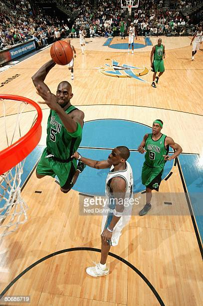 Kevin Garnett of the Boston Celtics goes to the basket over Antawn Jamison of the Washington Wizards during the game on April 9 2008 at the Verizon...