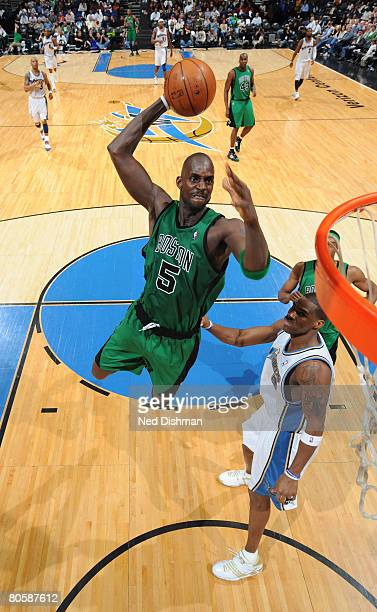 Kevin Garnett of the Boston Celtics goes up for a dunk against Antawn Jamison of the Washington Wizards at the Verizon Center on April 9 2008 in...