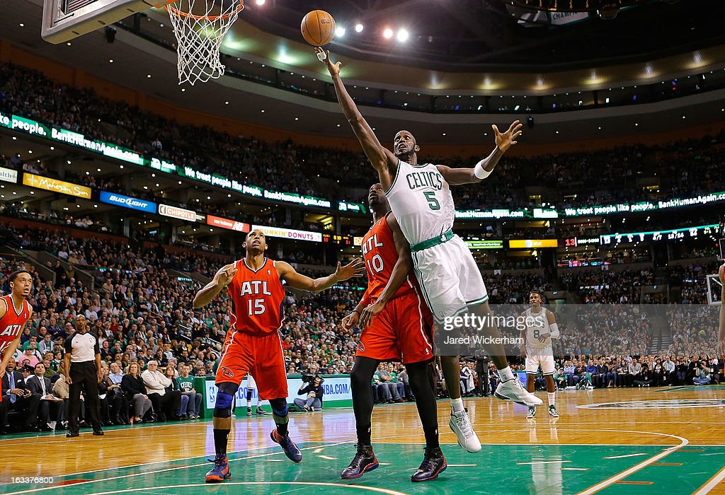 Kevin Garnett #5 of the Boston Celtics goes up for a layup in front of Johan Petro #10 of the Atlanta Hawks during the game on March 8, 2013 at TD Garden in Boston, Massachusetts.