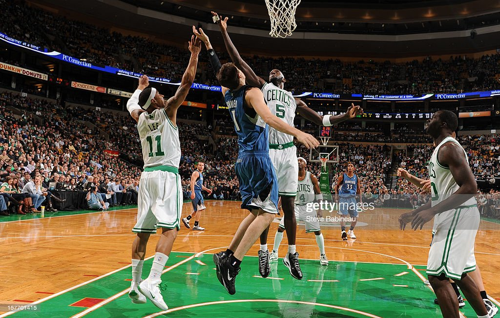 Kevin Garnett #5 of the Boston Celtics goes up for a rebound against Alexey Shved #1 of the Minnesota Timberwolves on December 5, 2012 at the TD Garden in Boston, Massachusetts.