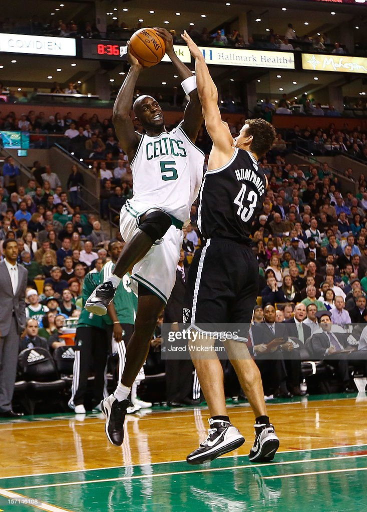Kevin Garnett #5 of the Boston Celtics goes up for a shot in front of Kris Humphries #43 of the Brooklyn Nets during the game on November 28, 2012 at TD Garden in Boston, Massachusetts. Garnett would be fouled on the play which would start a fight between members of the two teams.