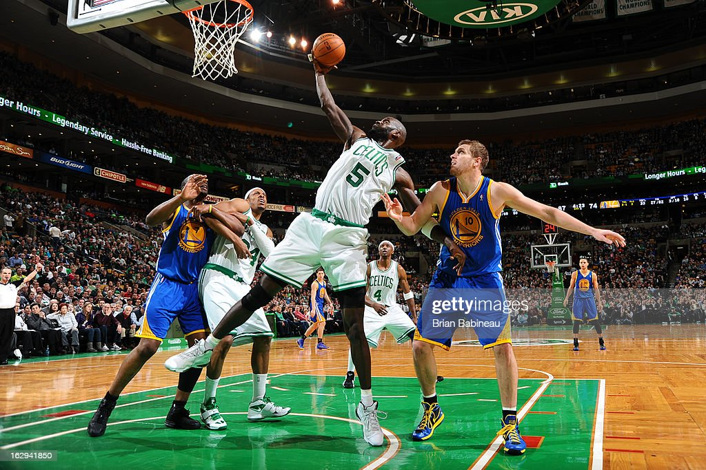 Kevin Garnett #5 of the Boston Celtics grabs a rebound against David Lee #10 of the Golden State Warriors on March 1, 2013 at the TD Garden in Boston, Massachusetts.