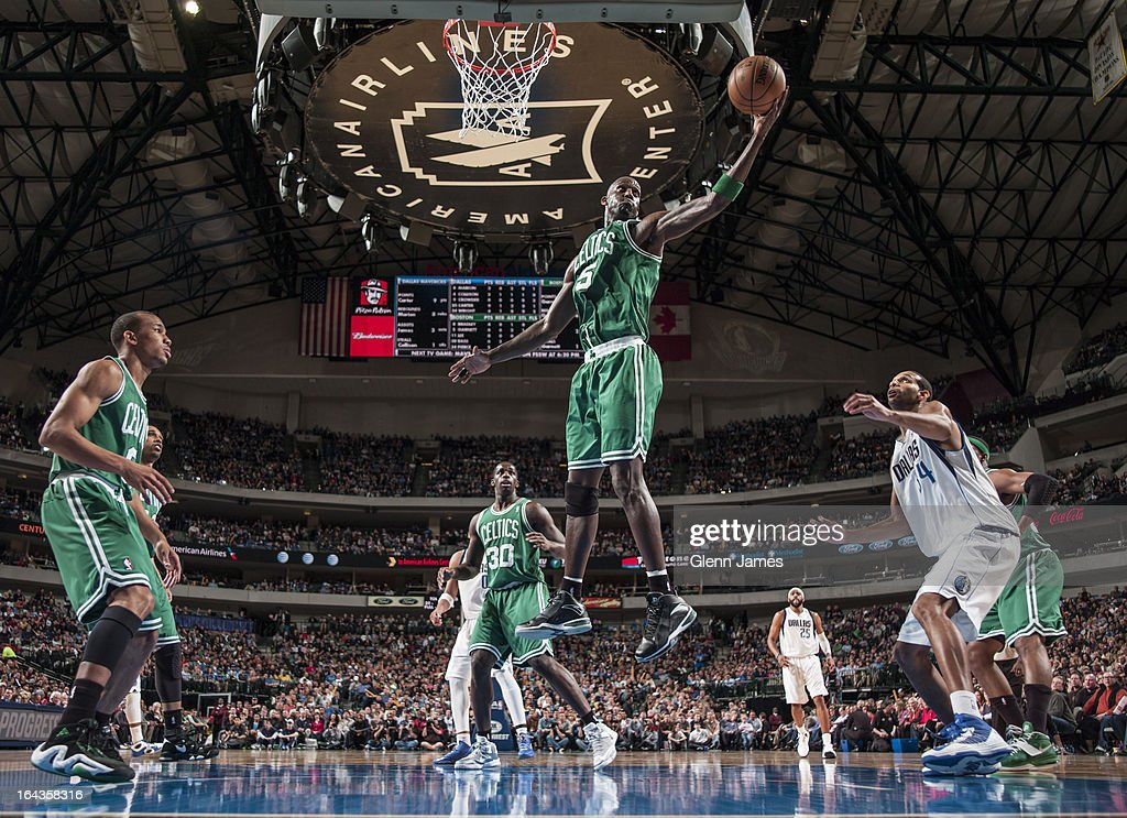 Kevin Garnett #5 of the Boston Celtics grabs a rebound against the Dallas Mavericks on March 22, 2013 at the American Airlines Center in Dallas, Texas.
