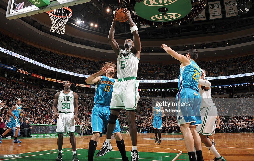 Kevin Garnett #5 of the Boston Celtics grabs the rebound against the New Orleans Hornets on January 16, 2013 at the TD Garden in Boston, Massachusetts.