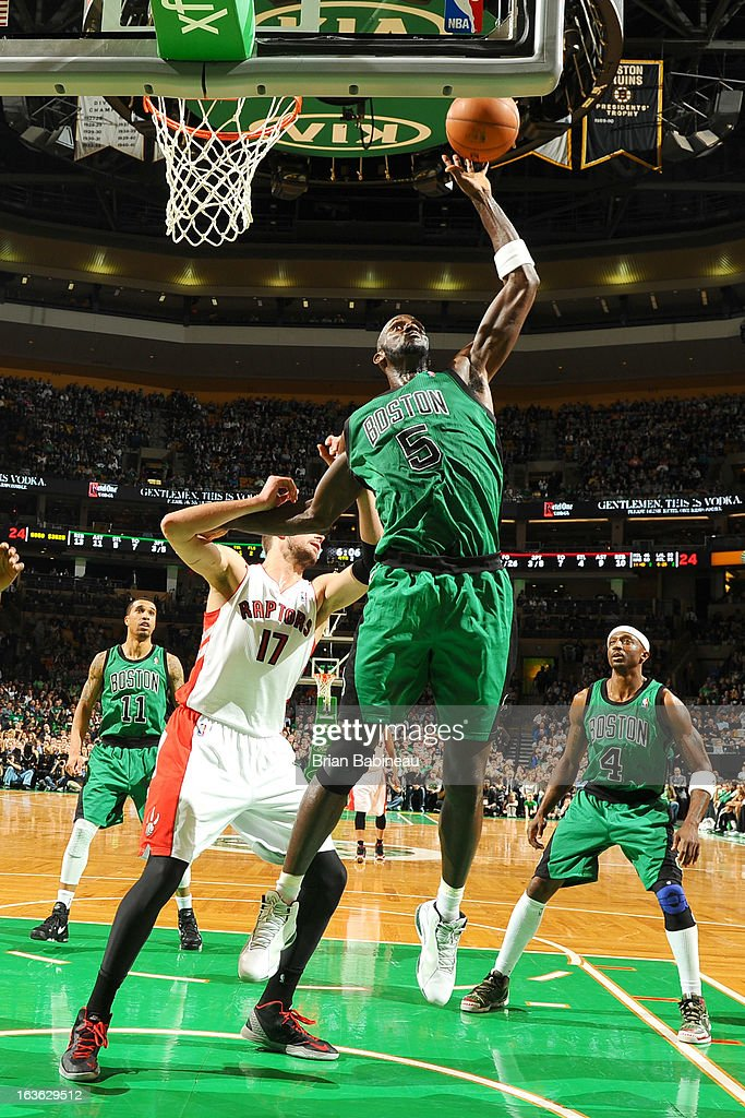 Kevin Garnett #5 of the Boston Celtics grabs the rebound against the Toronto Raptors on March 13, 2013 at the TD Garden in Boston, Massachusetts.