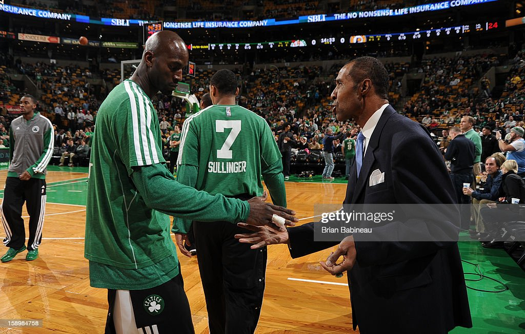 Kevin Garnett #5 of the Boston Celtics greets former NBA player Jo Jo White before the game against the Indiana Pacers on January 4, 2013 at the TD Garden in Boston, Massachusetts.
