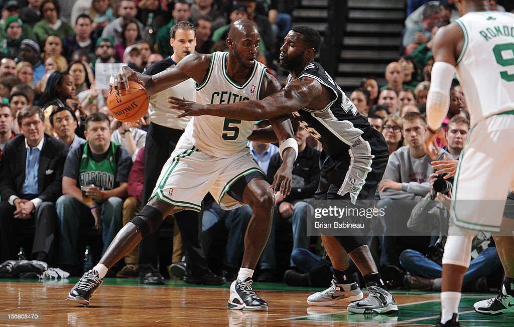 Kevin Garnett #5 of the Boston Celtics handles the ball against DeJuan Blair #45 of the San Antonio Spurs on November 21, 2012 at the TD Garden in Boston, Massachusetts.