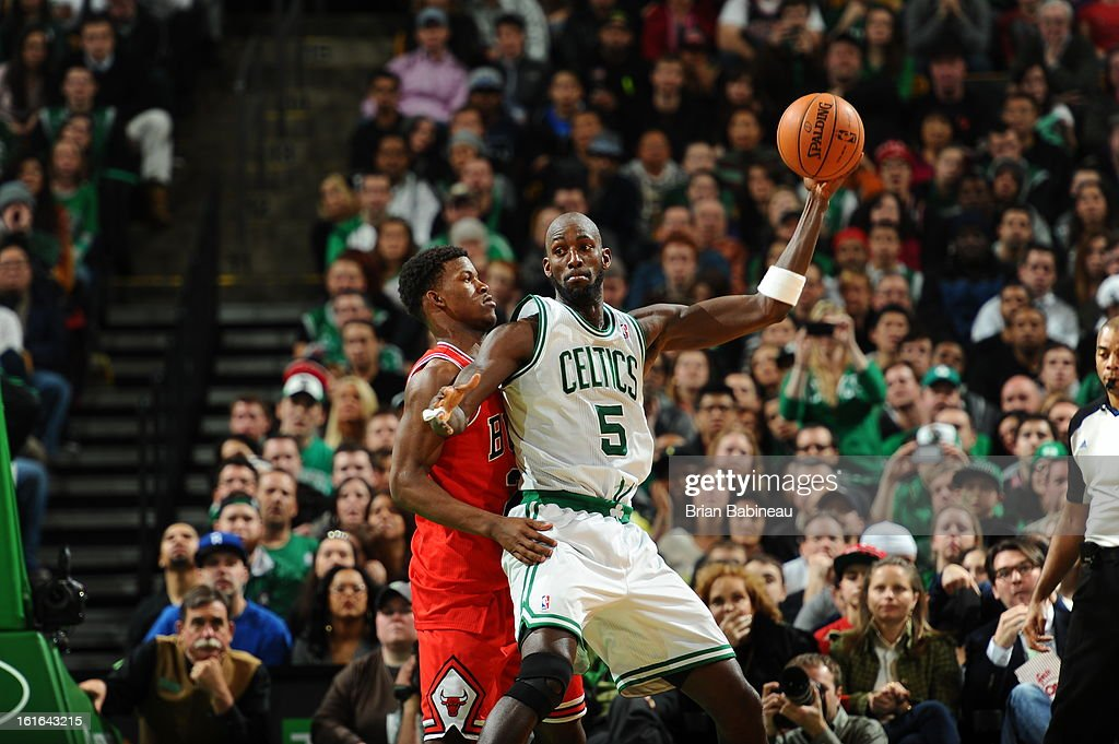 <a gi-track='captionPersonalityLinkClicked' href=/galleries/search?phrase=Kevin+Garnett&family=editorial&specificpeople=201473 ng-click='$event.stopPropagation()'>Kevin Garnett</a> #5 of the Boston Celtics handles the ball against <a gi-track='captionPersonalityLinkClicked' href=/galleries/search?phrase=Jimmy+Butler+-+Jogador+de+basquetebol&family=editorial&specificpeople=9860567 ng-click='$event.stopPropagation()'>Jimmy Butler</a> #21 of the Chicago Bulls on February 13, 2013 at the TD Garden in Boston, Massachusetts.