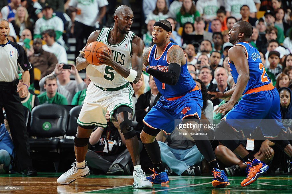 Kevin Garnett #5 of the Boston Celtics holds the ball against Carmelo Anthony #7 of the New York Knicks during Game Three of the Eastern Conference Quarterfinals on April 26, 2013 at the TD Garden in Boston, Massachusetts.