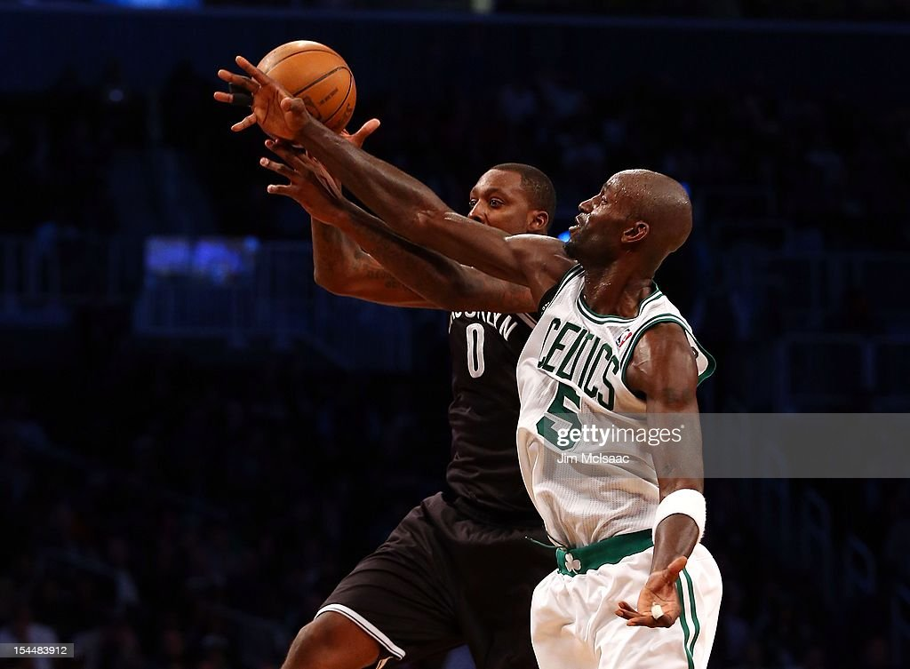 Kevin Garnett #5 of the Boston Celtics in action against Andray Blatche #0 of the Brooklyn Nets during a preseason game at the Barclays Center on October 18, 2012 in the Brooklyn borough of New York City. The Celtics defeated the Nets 115-85.