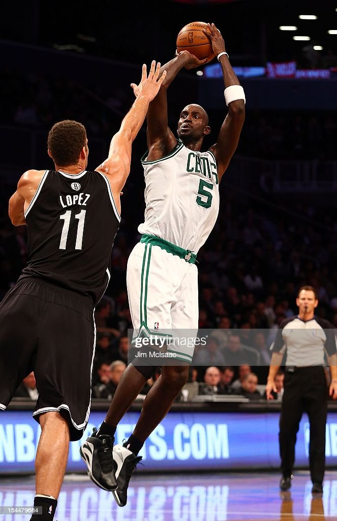 Kevin Garnett #5 of the Boston Celtics in action against Brook Lopez #11 of the Brooklyn Nets during a preseason game at the Barclays Center on October 18, 2012 in the Brooklyn borough of New York City. The Celtics defeated the Nets 115-85.
