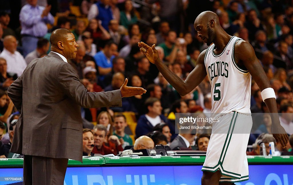 Kevin Garnett #5 of the Boston Celtics is congratulated by head coach Doc Rivers against the Minnesota Timberwolves during the game on December 5, 2012 at TD Garden in Boston, Massachusetts.