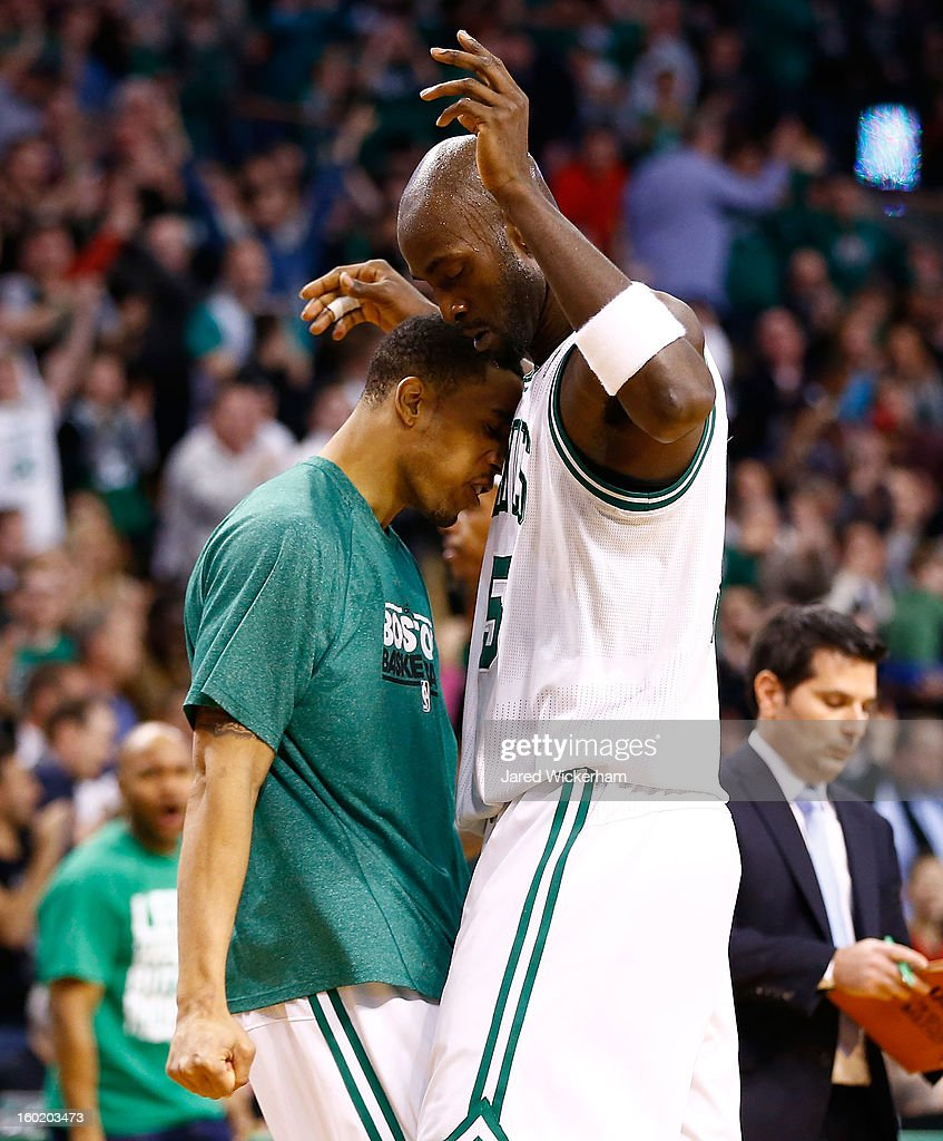 Kevin Garnett #5 of the Boston Celtics is congratulated by teammate Courtney Lee #11 of the Boston Celtics after making a shot against the Miami Heat during the game on January 27, 2013 at TD Garden in Boston, Massachusetts.