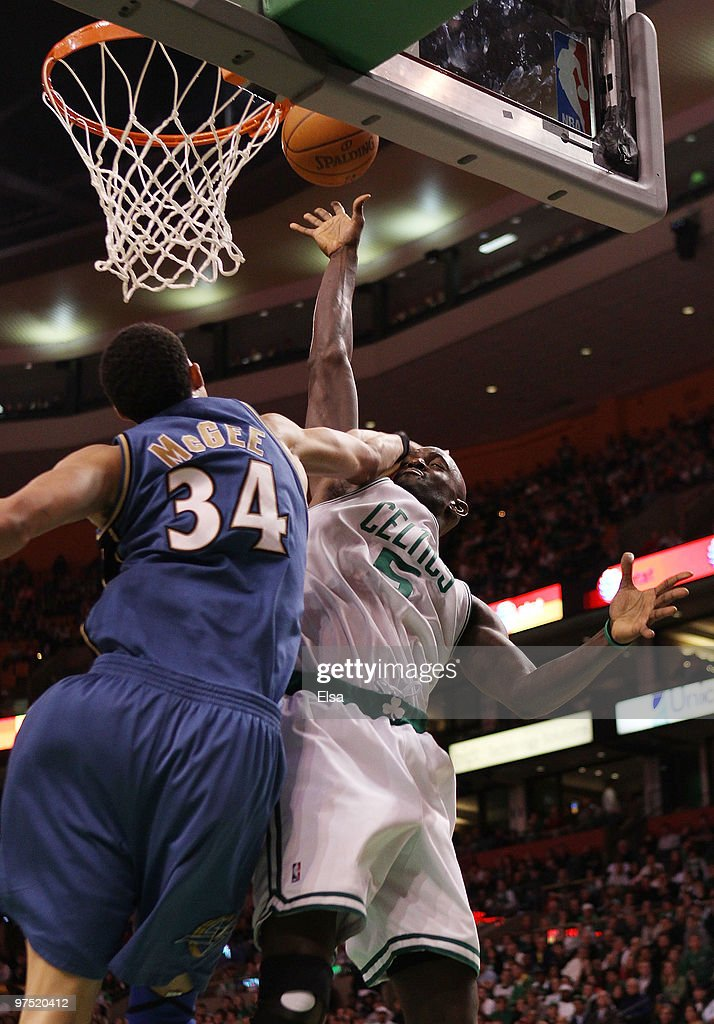 Kevin Garnett of the Boston Celtics is fouled by JaVale McGee of the Washington Wizards on March 7 2010 at the TD Garden in Boston Massachusetts The...