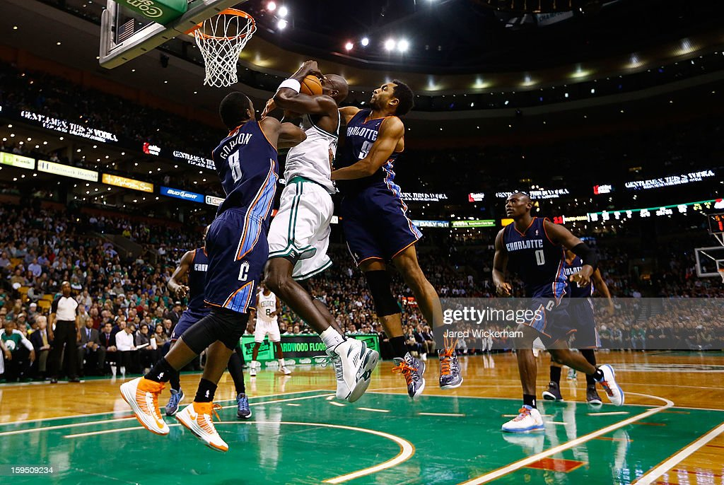 Kevin Garnett #5 of the Boston Celtics is fouled driving to the basket by Gerald Henderson #9 of the Charlotte Bobcats during the game on January 14, 2013 at TD Garden in Boston, Massachusetts.