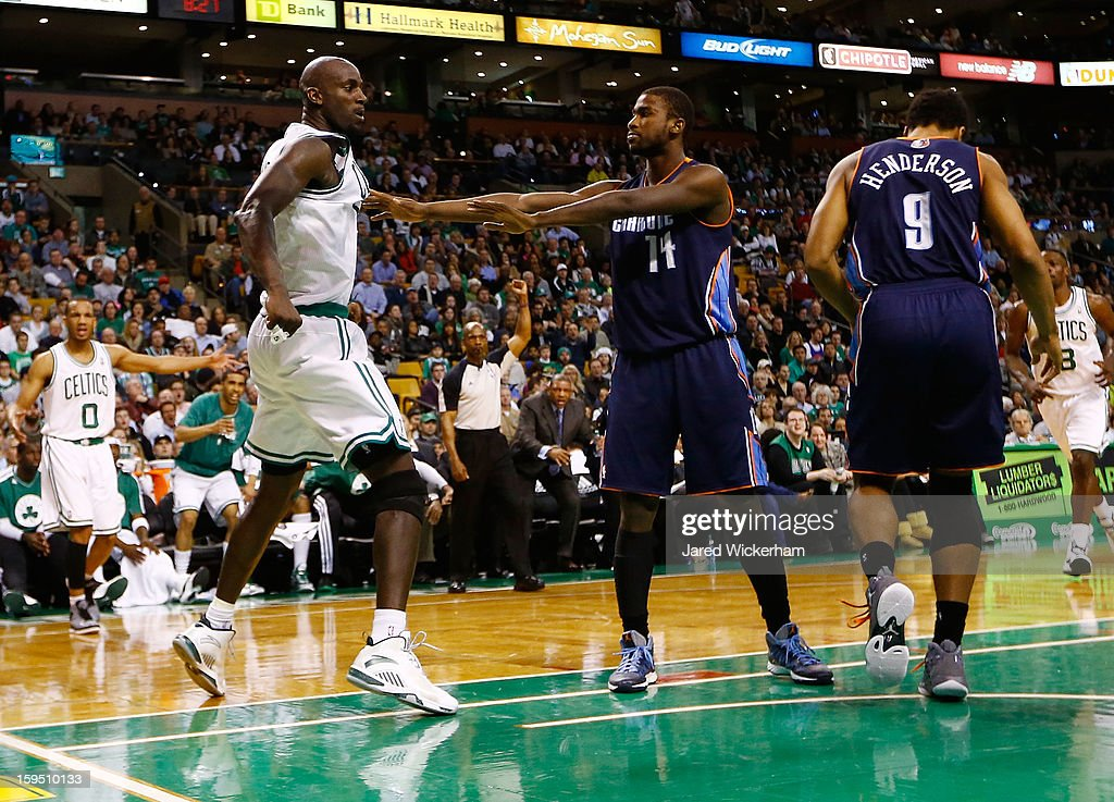Kevin Garnett #5 of the Boston Celtics is pushed back by Michael Kidd-Gilchrist #14 of the Charlotte Bobcats after being fouled by Gerald Henderson #9 of the Charlotte Bobcats during the game on January 14, 2013 at TD Garden in Boston, Massachusetts.