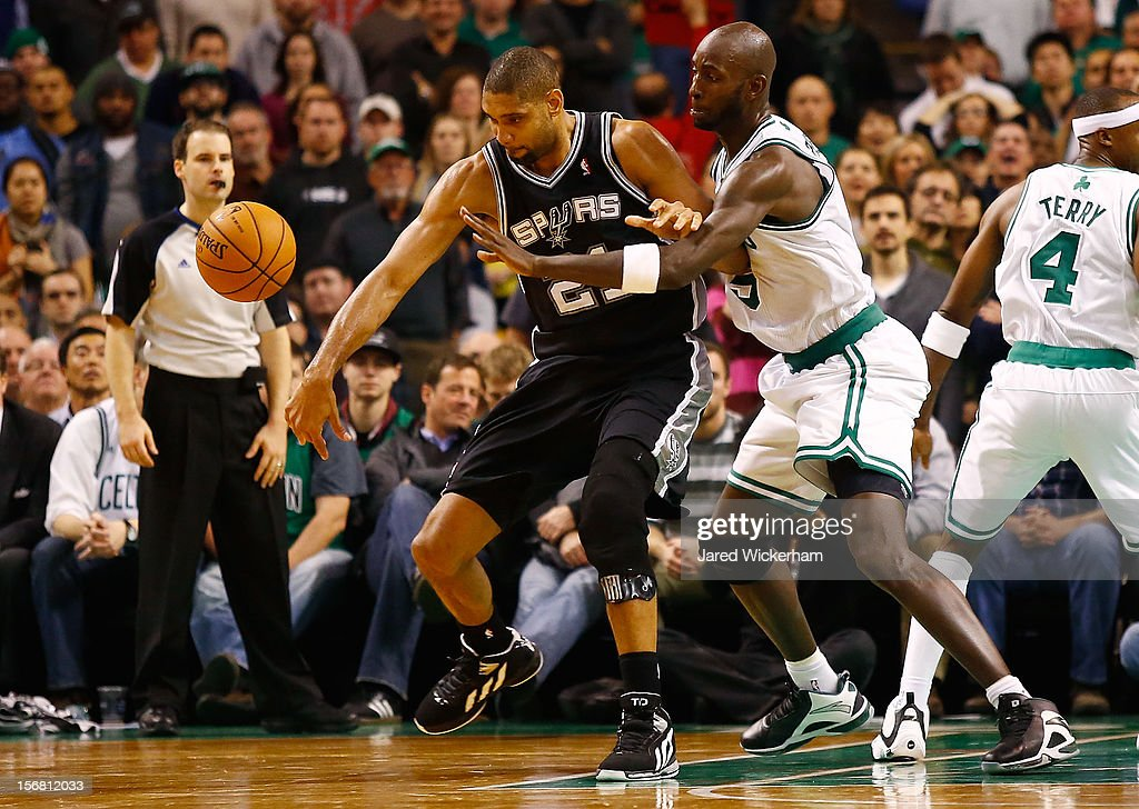 Kevin Garnett #5 of the Boston Celtics knocks the ball out of the hands of Tim Duncan #21 of the San Antonio Spurs during the game on November 21, 2012 at TD Garden in Boston, Massachusetts.