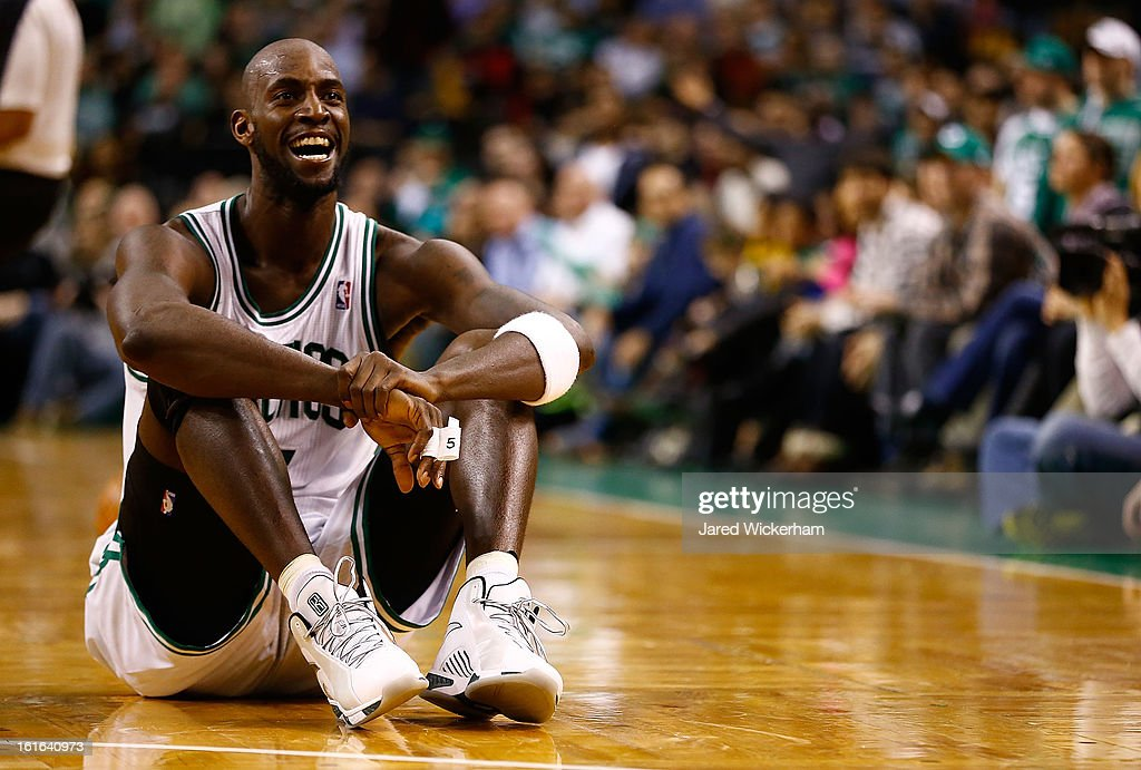 Kevin Garnett #5 of the Boston Celtics laughs while sitting on the court after fighting for possession of the ball against the Chicago Bulls during the game on February 13, 2013 at TD Garden in Boston, Massachusetts.