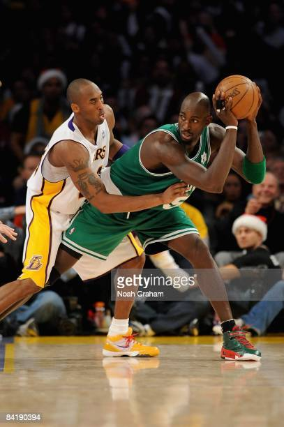Kevin Garnett of the Boston Celtics looks for an open pass over Kobe Bryant of the Los Angeles Lakers during the game on December 25 2008 at Staples...