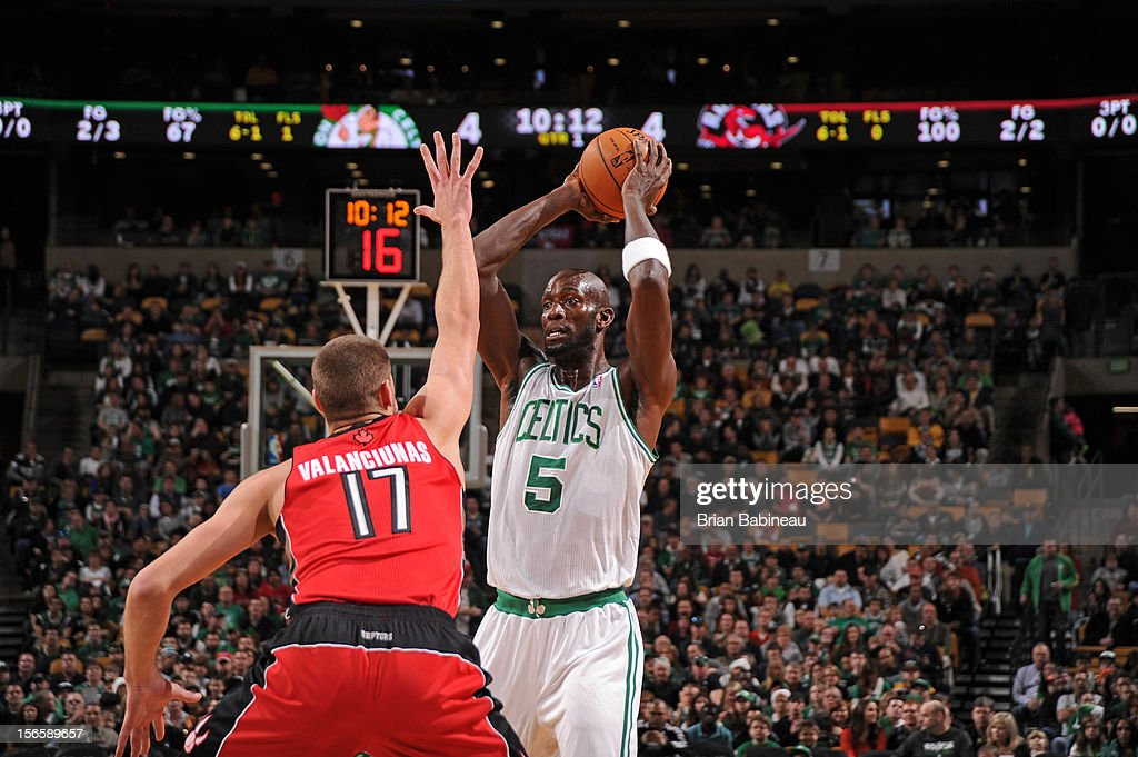 Kevin Garnett #5 of the Boston Celtics looks to pass over Jonas Valanciunas #17 of the Toronto Raptors on November 17, 2012 at the TD Garden in Boston, Massachusetts.