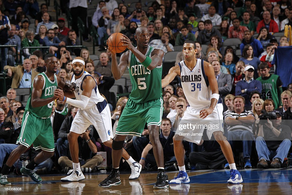 Kevin Garnett #5 of the Boston Celtics looks to pass the ball against Brandan Wright #34 of the Dallas Mavericks on March 22, 2013 at the American Airlines Center in Dallas, Texas.