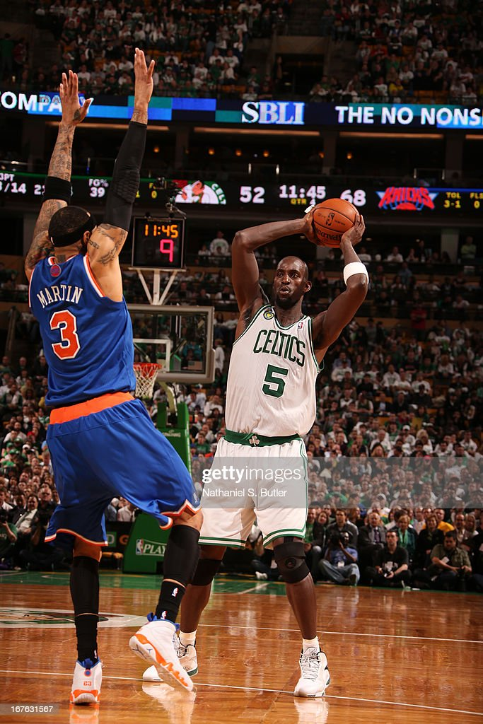 Kevin Garnett #5 of the Boston Celtics looks to pass the ball against Kenyon Martin #3 of the New York Knicks in Game Three of the Eastern Conference Quarterfinals during the 2013 NBA Playoffs on April 26, 2013 at the TD Garden in Boston.