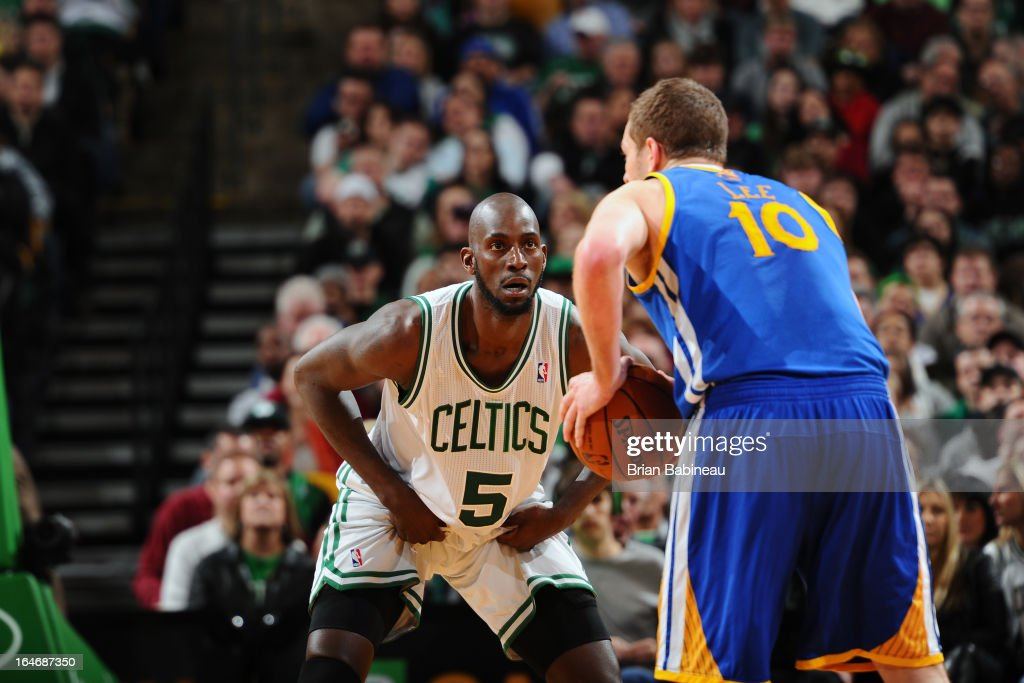 Kevin Garnett #5 of the Boston Celtics plays defense against David Lee #10 of the Golden State Warriors on March 1, 2013 at the TD Garden in Boston, Massachusetts.