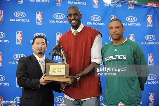 Kevin Garnett of the Boston Celtics poses as he receives the NBA Defensive Player of the Year award presented by KIA at the Boston Celtics practice...