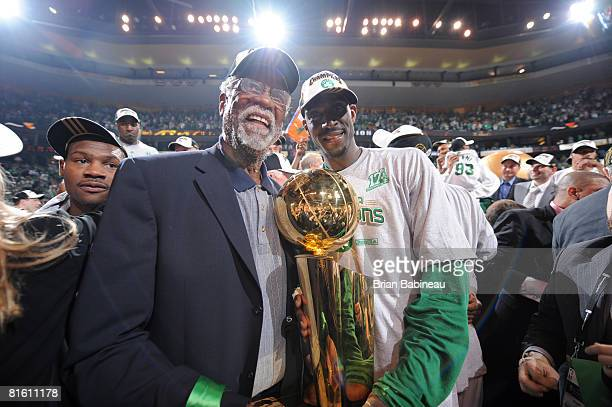 Kevin Garnett of the Boston Celtics poses with former Boston Celtic Bill Russell after defeating the Los Angeles Lakers during Game Six of the NBA...