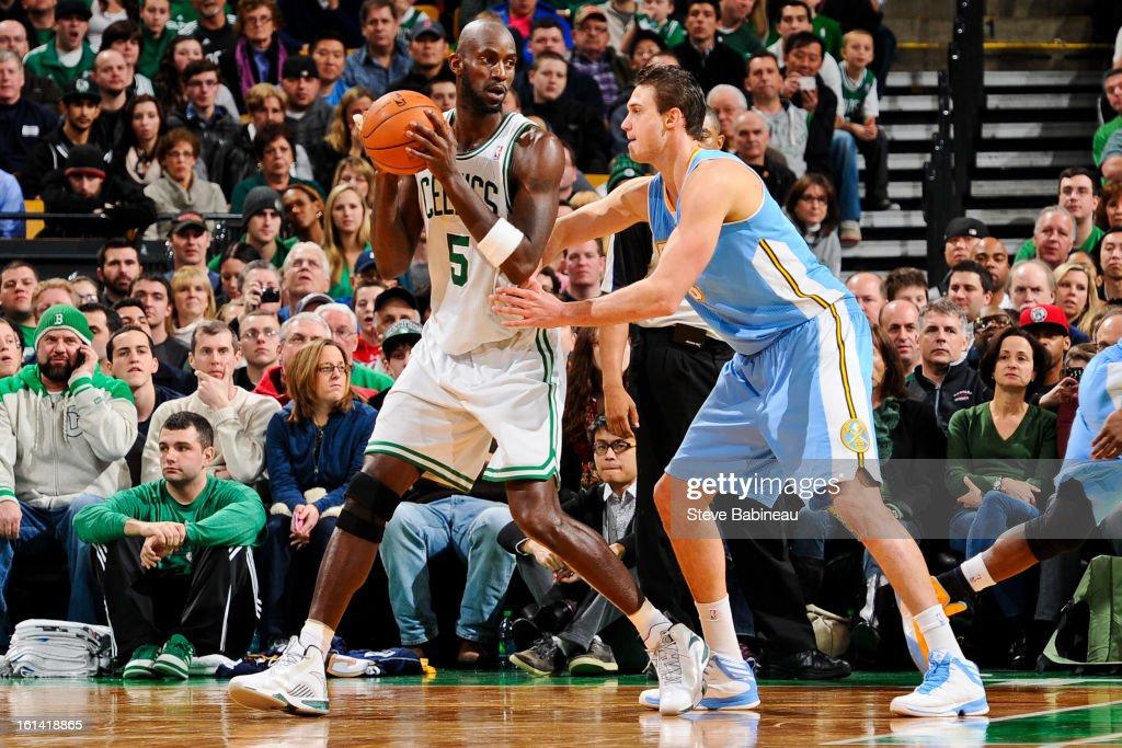 Kevin Garnett #5 of the Boston Celtics posts up against Danilo Gallinari #8 of the Denver Nuggets on February 10, 2013 at the TD Garden in Boston, Massachusetts.