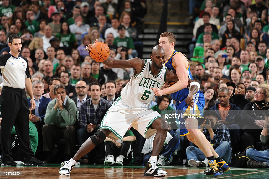 <a gi-track='captionPersonalityLinkClicked' href=/galleries/search?phrase=Kevin+Garnett&family=editorial&specificpeople=201473 ng-click='$event.stopPropagation()'>Kevin Garnett</a> #5 of the Boston Celtics posts up against David Lee #10 of the Golden State Warriors on March 4, 2011 at the TD Garden in Boston, Massachusetts.