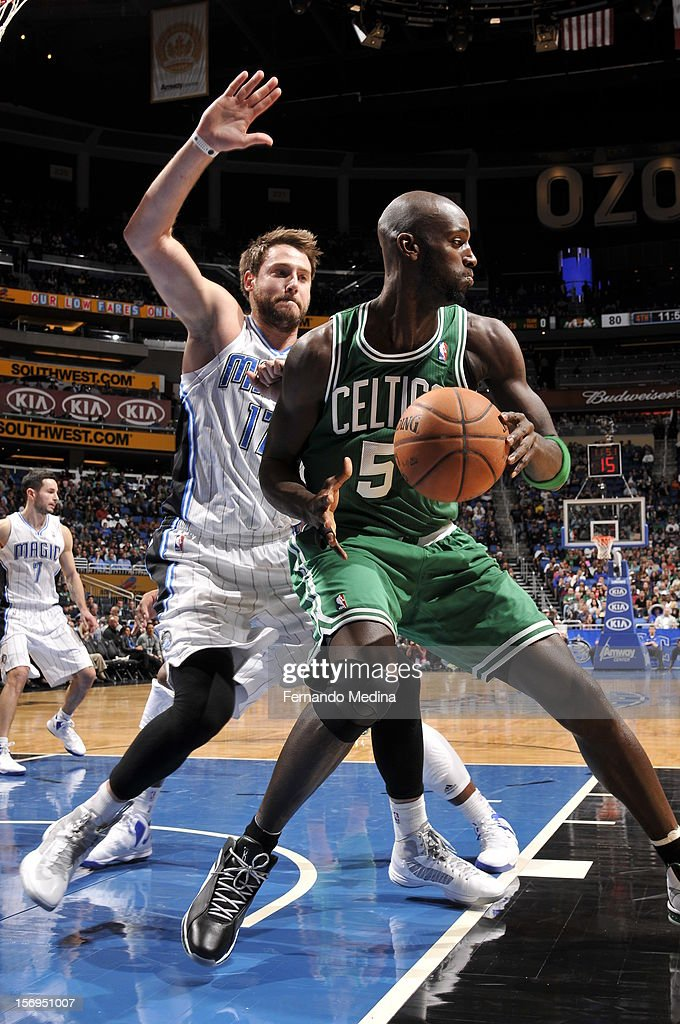 Kevin Garnett #5 of the Boston Celtics protects the ball from Josh McRoberts #17 of the Orlando Magic during the game between the Boston Celtics and the Orlando Magic on November 25, 2012 at Amway Center in Orlando, Florida.