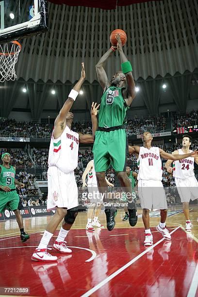 Kevin Garnett of the Boston Celtics puts up a shot over Chris Bosh of the Toronto Raptors during the NBA preseason game as part of the 2007 NBA...