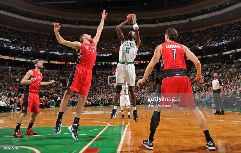 Kevin Garnett #5 of the Boston Celtics puts up a shot over Jonas Valanciunas #17 of the Toronto Raptors on November 17, 2012 at the TD Garden in Boston, Massachusetts.