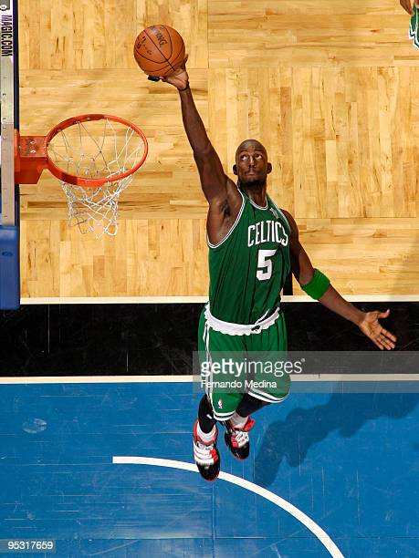Kevin Garnett of the Boston Celtics reaches for a rebound against the Orlando Magic during the game on December 25 2009 at Amway Arena in Orlando...