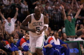 Kevin Garnett of the Boston Celtics reacts in the fourth after sinking a shot against the Philadelphia 76ers during Game Seven of the Eastern...