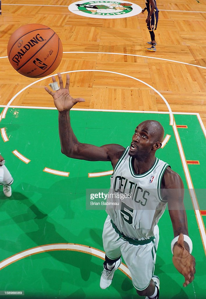 Kevin Garnett #5 of the Boston Celtics rebounds against the Indiana Pacers on January 4, 2013 at the TD Garden in Boston, Massachusetts.