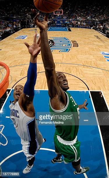 Kevin Garnett of the Boston Celtics rebounds the ball against Glen Davis of the Orlando Magic during the game on January 26 2012 at Amway Center in...