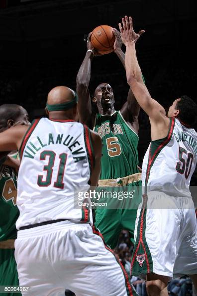 Kevin Garnett of the Boston Celtics shoots a jumpshot against Charlie Villanueva and Dan Gadzuric of the Milwaukee Bucks on March 15 2008 at the...