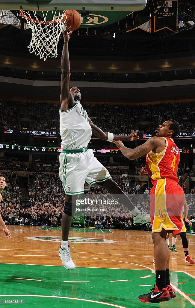 Kevin Garnett #5 of the Boston Celtics shoots a layup against Greg Smith #4 of the Houston Rockets on January 11, 2013 at the TD Garden in Boston, Massachusetts.