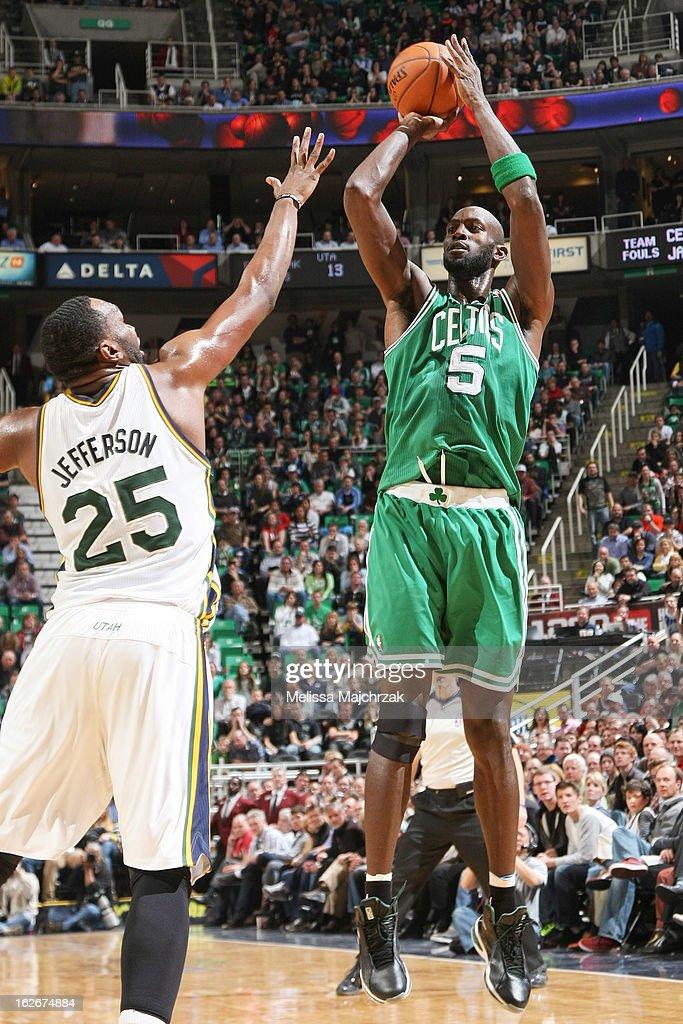 Kevin Garnett #5 of the Boston Celtics shoots against Al Jefferson #25 the Utah Jazz at Energy Solutions Arena on February 25, 2013 in Salt Lake City, Utah.