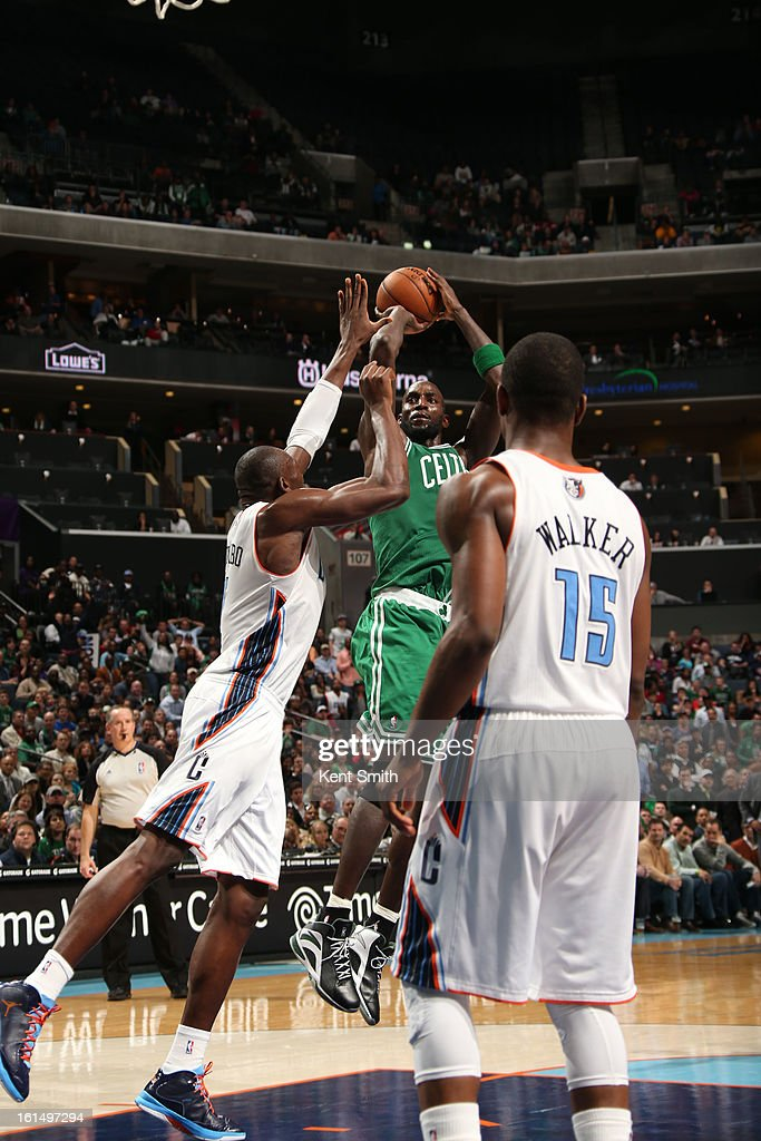 <a gi-track='captionPersonalityLinkClicked' href=/galleries/search?phrase=Kevin+Garnett&family=editorial&specificpeople=201473 ng-click='$event.stopPropagation()'>Kevin Garnett</a> #5 of the Boston Celtics shoots against <a gi-track='captionPersonalityLinkClicked' href=/galleries/search?phrase=Bismack+Biyombo&family=editorial&specificpeople=7640443 ng-click='$event.stopPropagation()'>Bismack Biyombo</a> #0 of the Charlotte Bobcats at the Time Warner Cable Arena on February 11, 2013 in Charlotte, North Carolina.