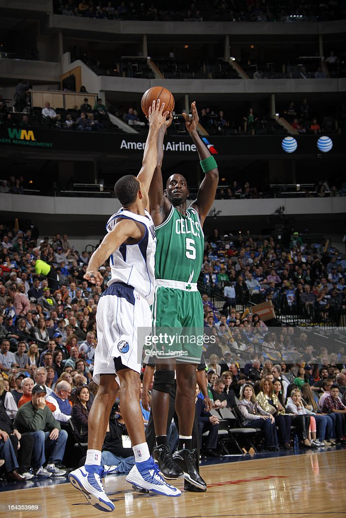 Kevin Garnett #5 of the Boston Celtics shoots against Brandan Wright #34 of the Dallas Mavericks on March 22, 2013 at the American Airlines Center in Dallas, Texas.