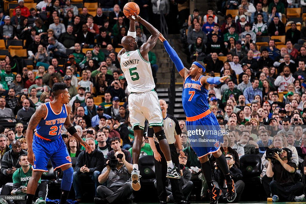 Kevin Garnett #5 of the Boston Celtics shoots against Carmelo Anthony #7 of the New York Knicks on January 24, 2013 at the TD Garden in Boston, Massachusetts.