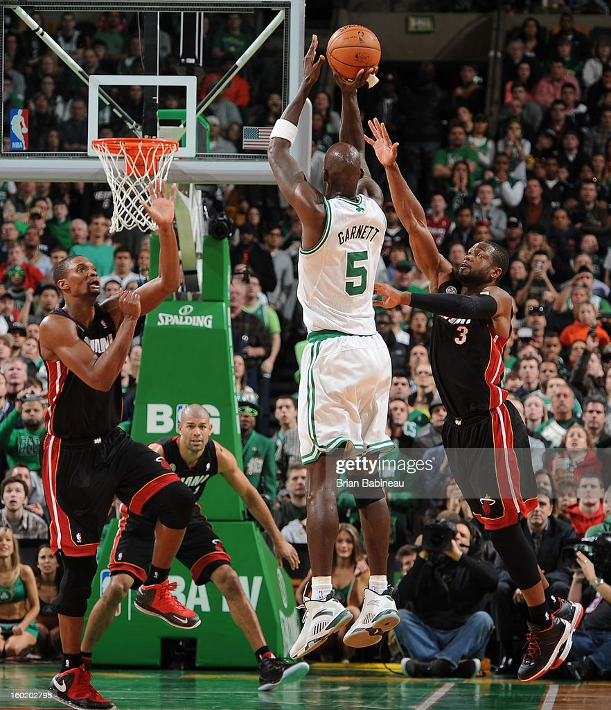 Kevin Garnett #5 of the Boston Celtics shoots against Chris Bosh #1 and Dwyane Wade #3 of the Miami Heat on January 27, 2013 at the TD Garden in Boston, Massachusetts.